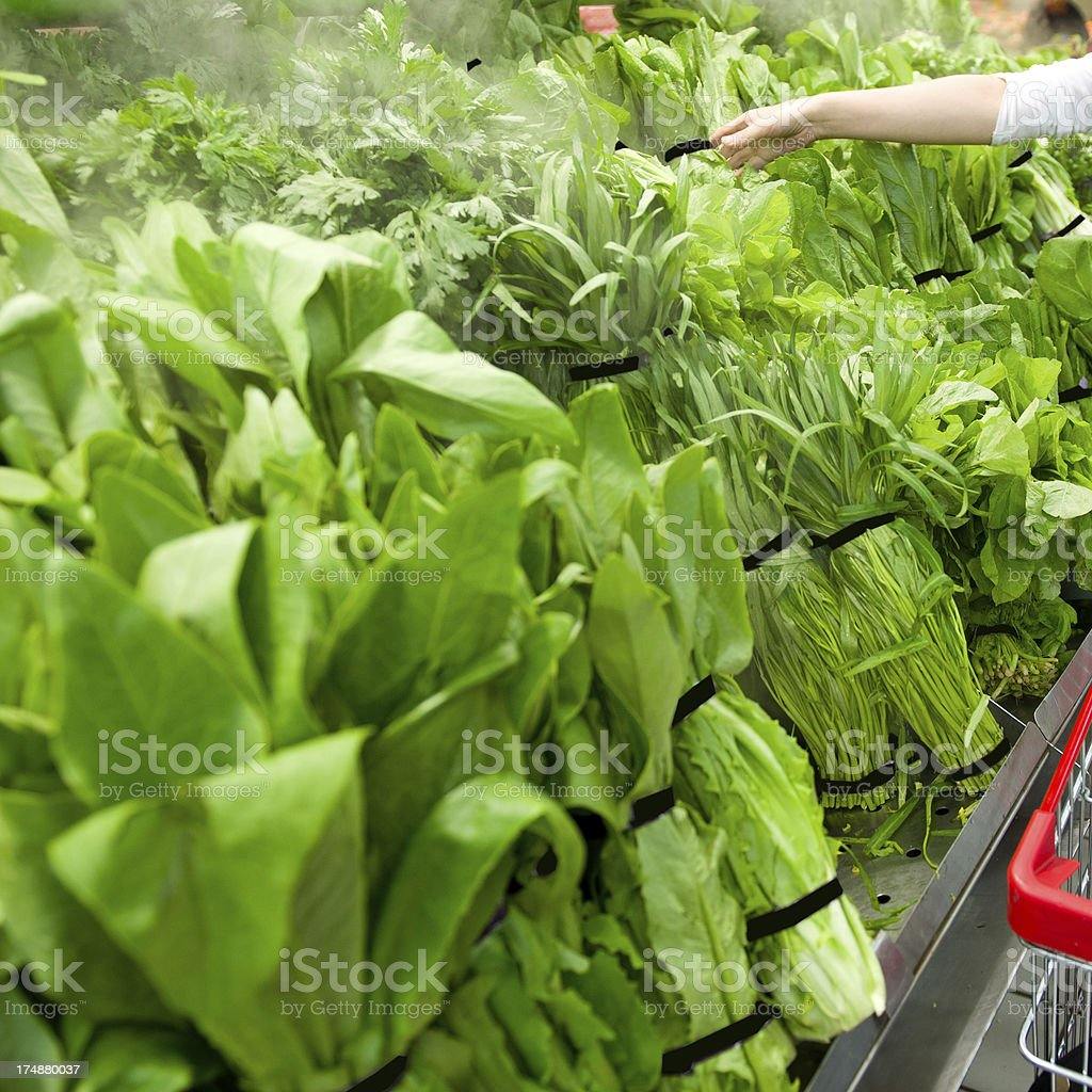 selecting leaf vegetable royalty-free stock photo