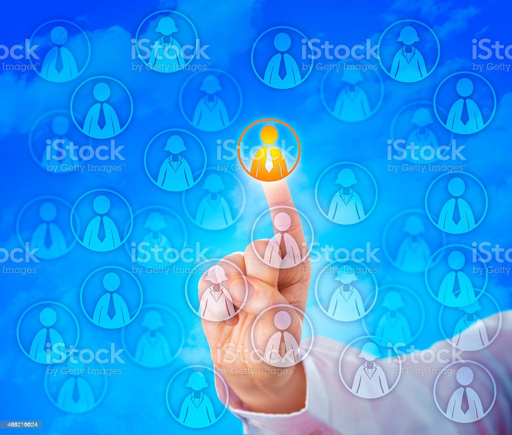 Selecting One Male Worker In A Virtual Crowd stock photo