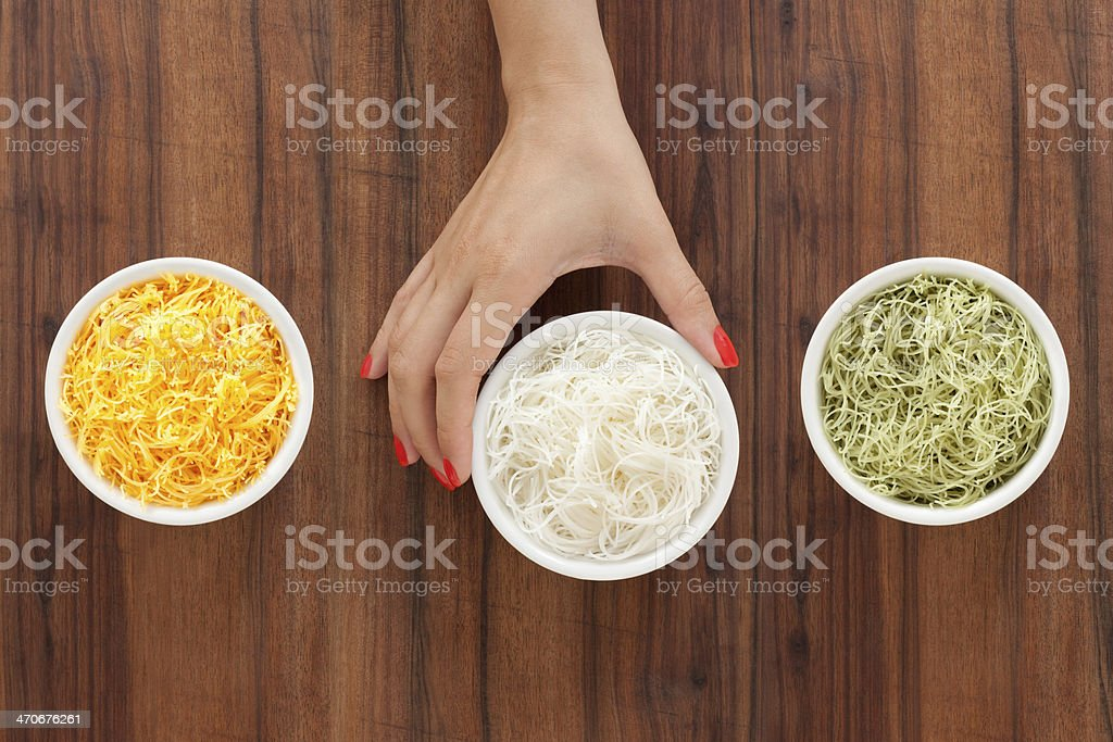 Selecting rice noodles royalty-free stock photo