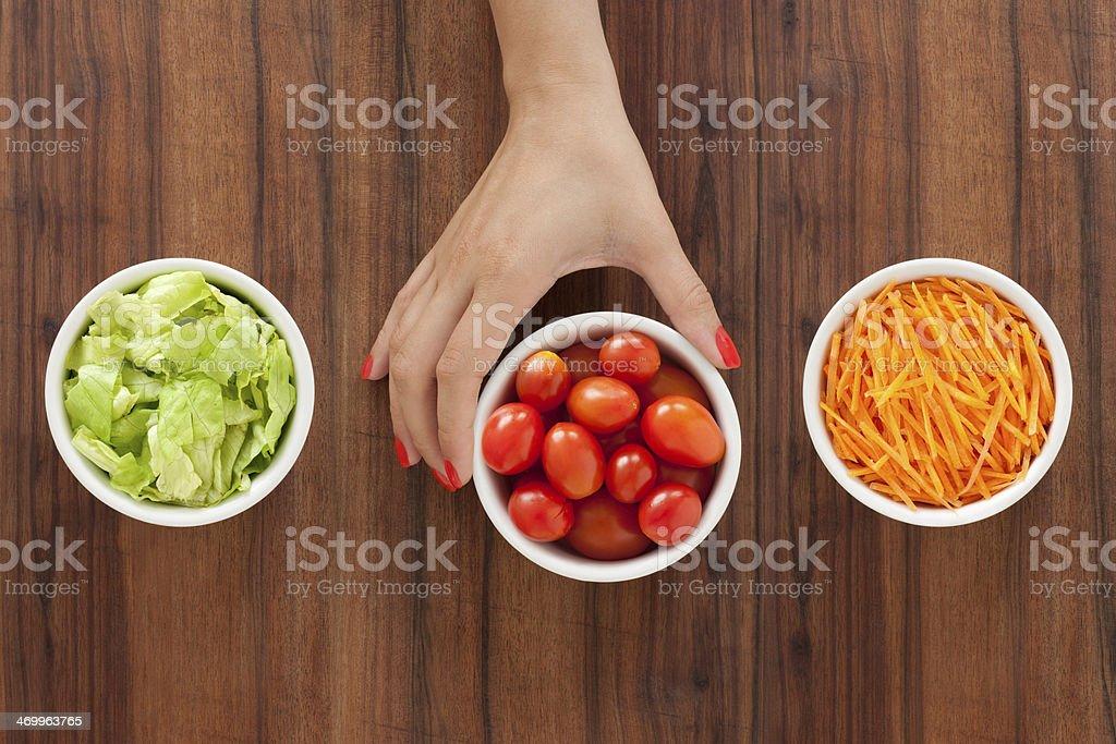 Selecting salad ingredients royalty-free stock photo