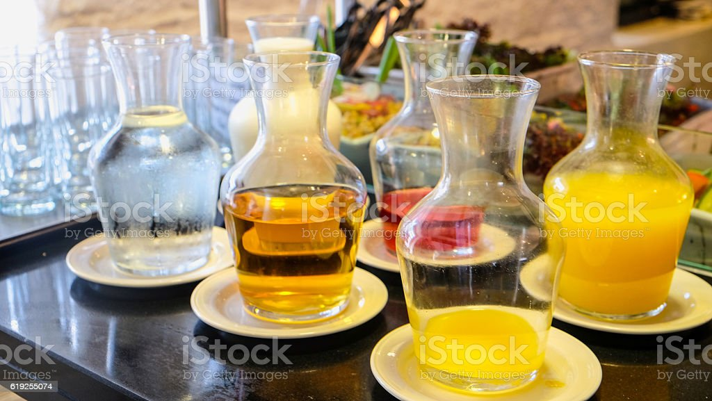 Selection fresh drinks at breakfast buffet stock photo