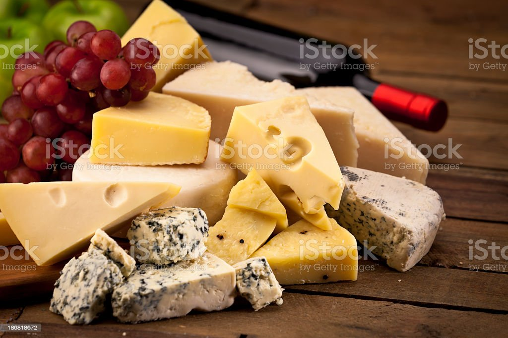 Selection of assorted cheese and grapes with wine stock photo