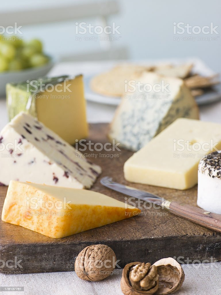 Selection of British Cheeses with Walnuts Biscuits and Grapes royalty-free stock photo