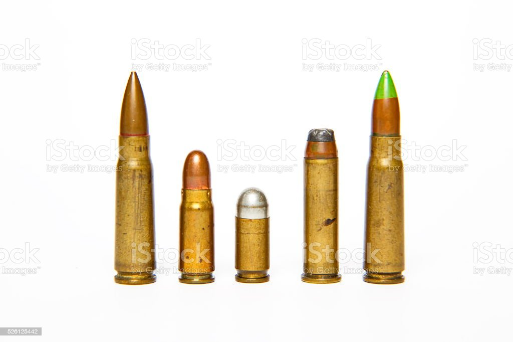 Selection of bullets isolated on white. stock photo