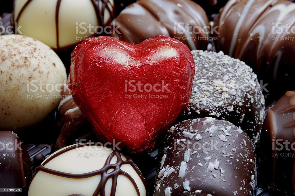 A selection of chocolates and a foil heart stock photo