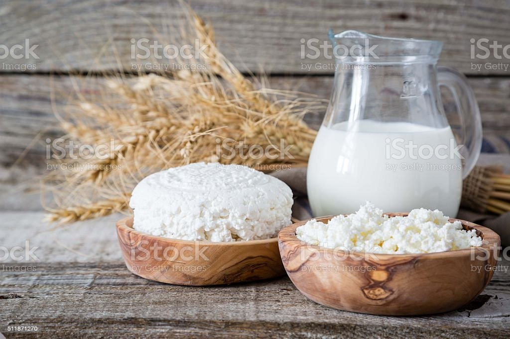 Selection of dairy products on rustic wood bacground stock photo