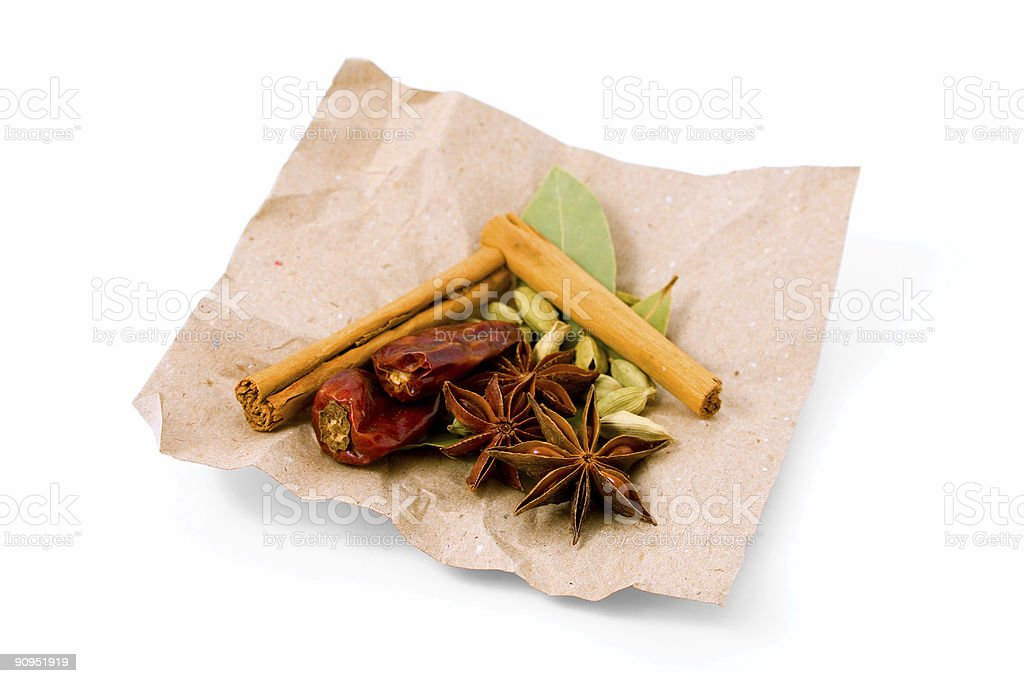Selection of Exotic Spices on brown paper royalty-free stock photo