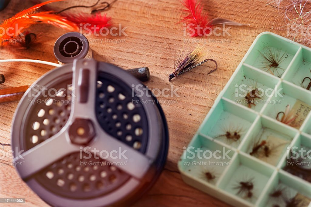 Selection of Fishing Flies Laid Out With Fishing Reel stock photo