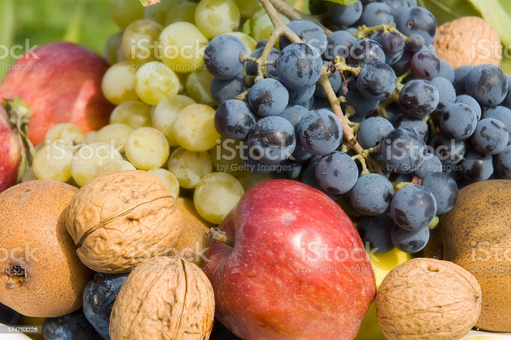Selection of fresh healthy fruit and nuts from Autumn stock photo