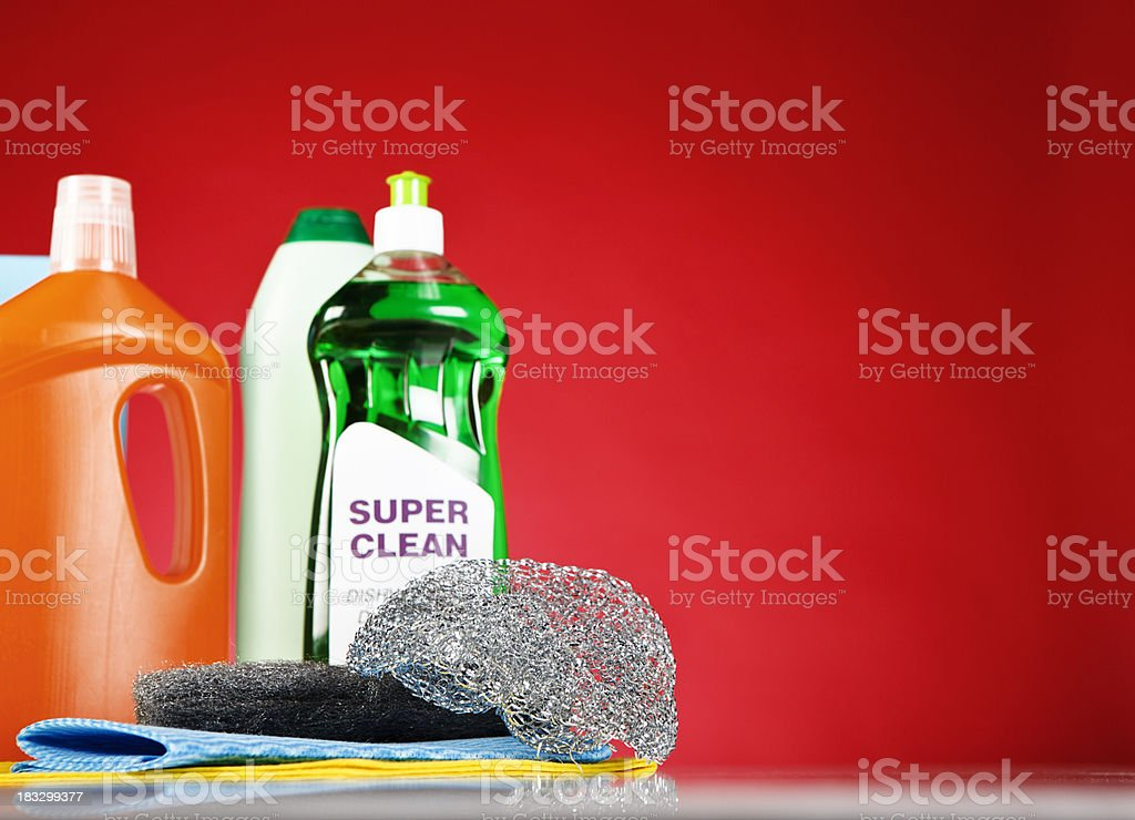 Selection of generic domestic cleaning essentials, isolated on red royalty-free stock photo