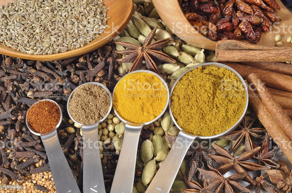 Selection of ground spices and seed in background royalty-free stock photo