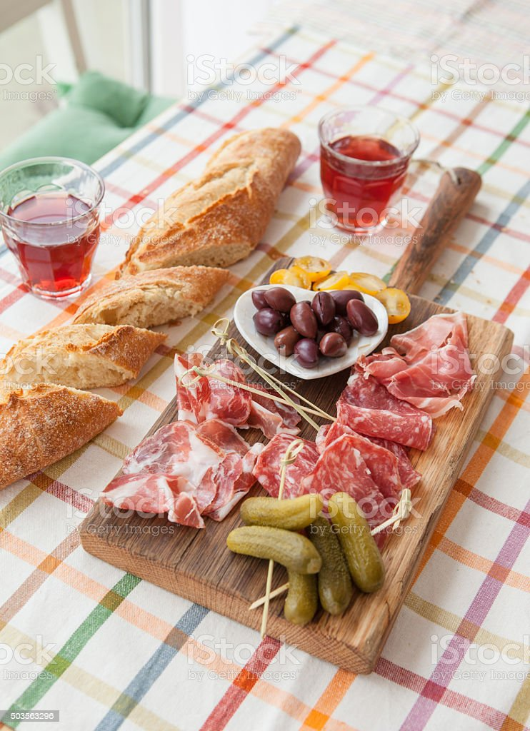 Selection of hams and salami stock photo