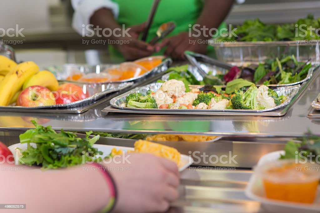 Selection of healthy foods in school cafeteria line stock photo