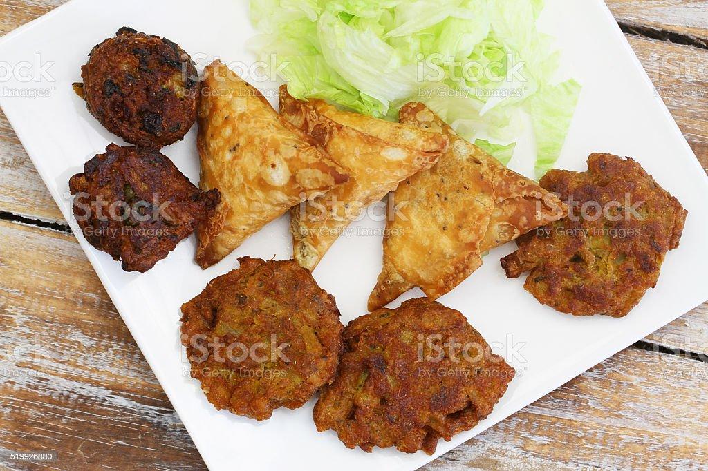 Selection of Indian snacks: pakoras, onion bhaji and samosas stock photo