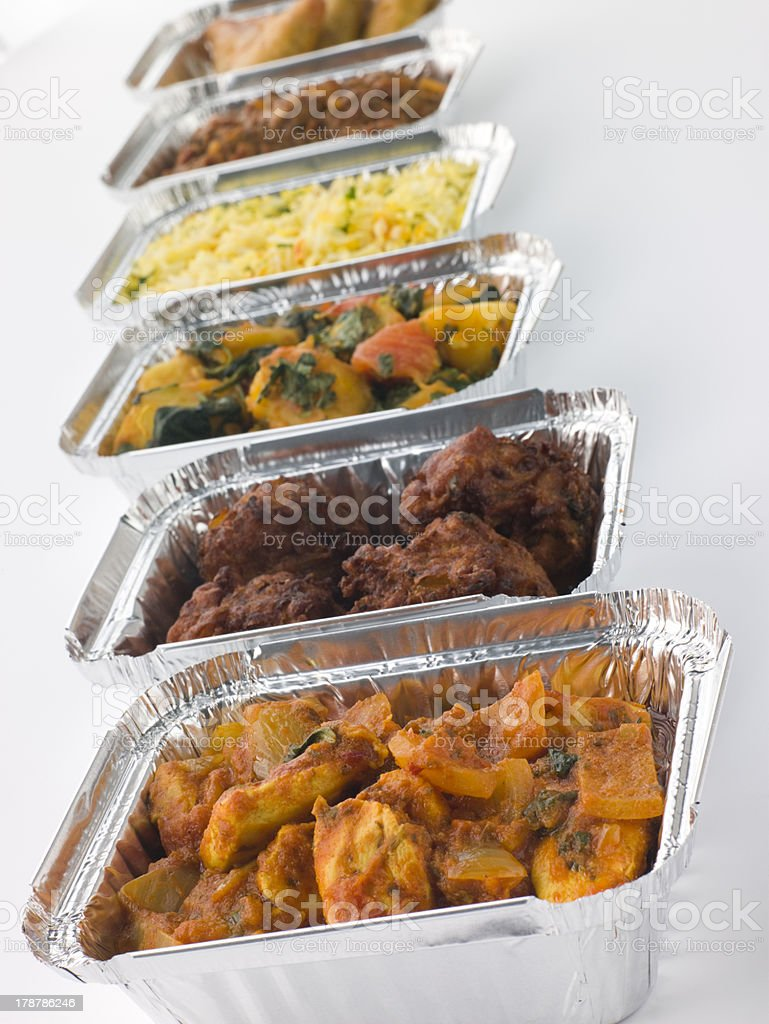 Selection Of Indian Take Away Dishes In Foil Containers stock photo