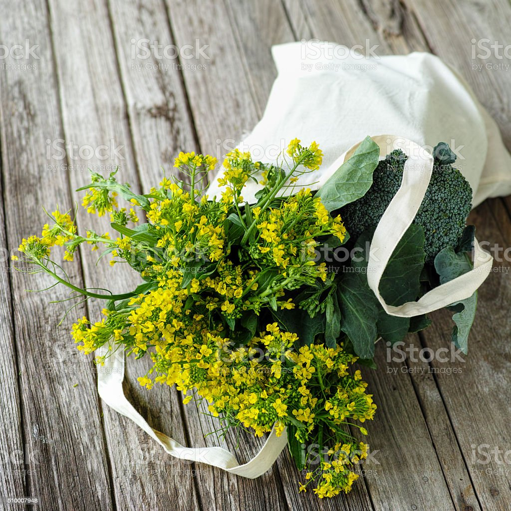 Selection of leafy green vegetables in a natural cotton bag. stock photo