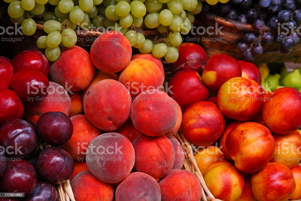 A selection of many fruits in a market stock photo