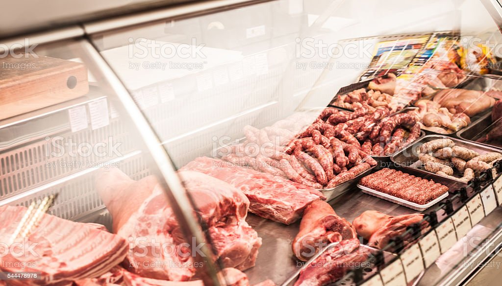 Selection of meat at a butcher shop stock photo