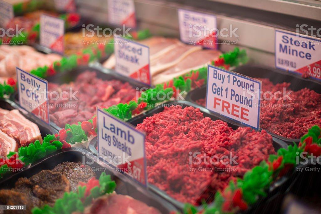 Selection of meats at the butchers shop stock photo