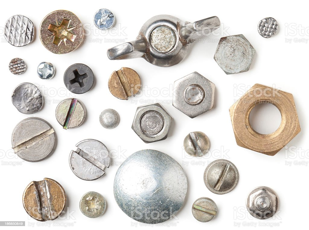 Selection of nail and screw heads stock photo