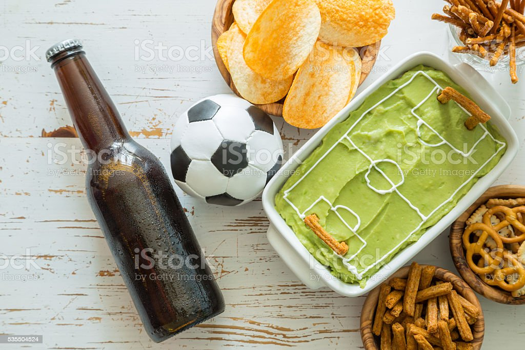 Selection of party food for watching football game stock photo