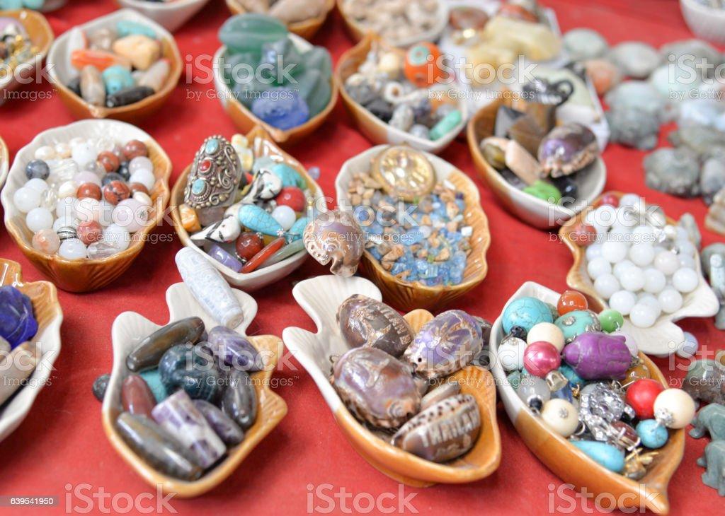 Selection of precious and semiprecious stones on the market stock photo