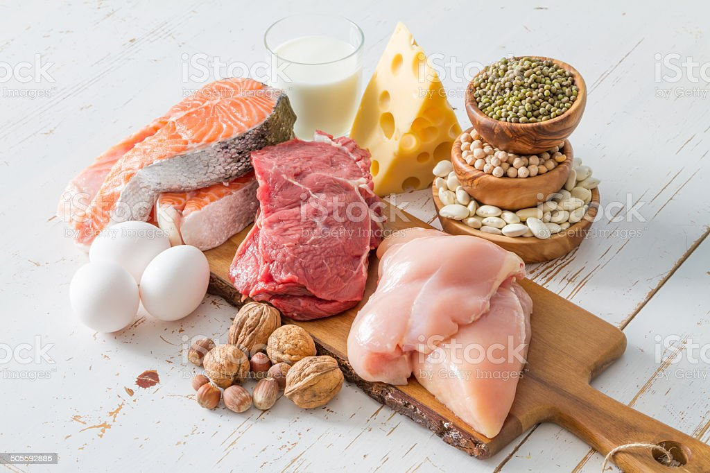 Selection of protein sources in kitchen background stock photo
