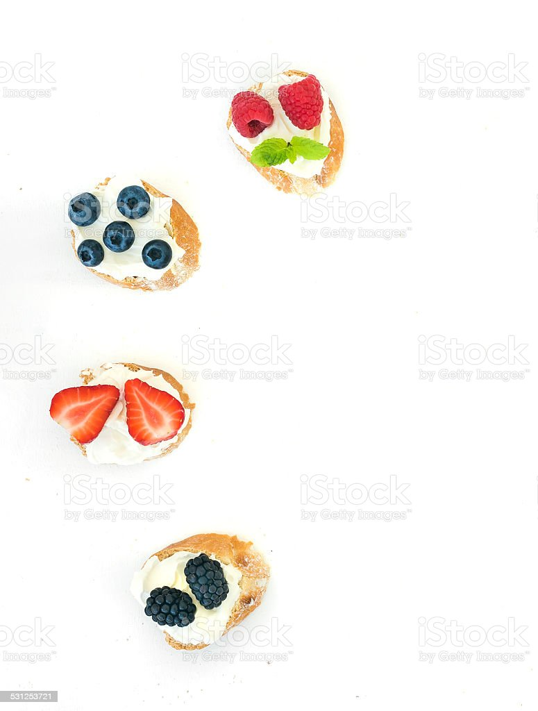 Selection of small sweet sandwiches with cream-cheese and fresh stock photo