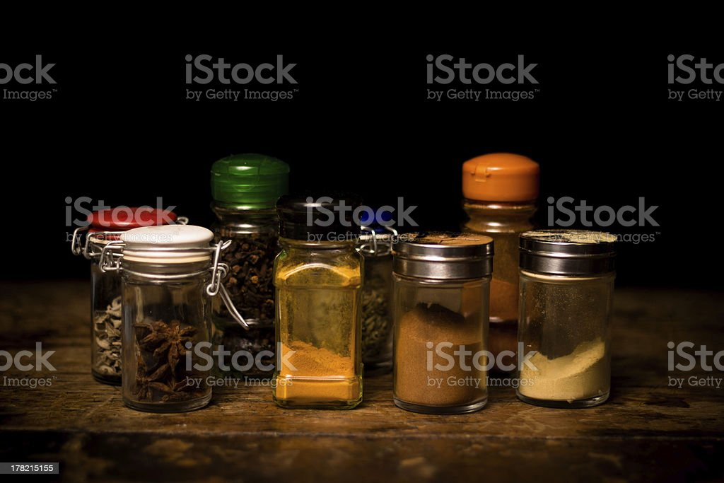Selection of spices in rustic setting stock photo