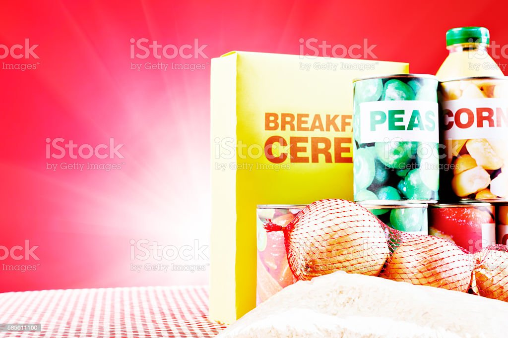 Selection of staple foods against spotlit red background with copyspace stock photo