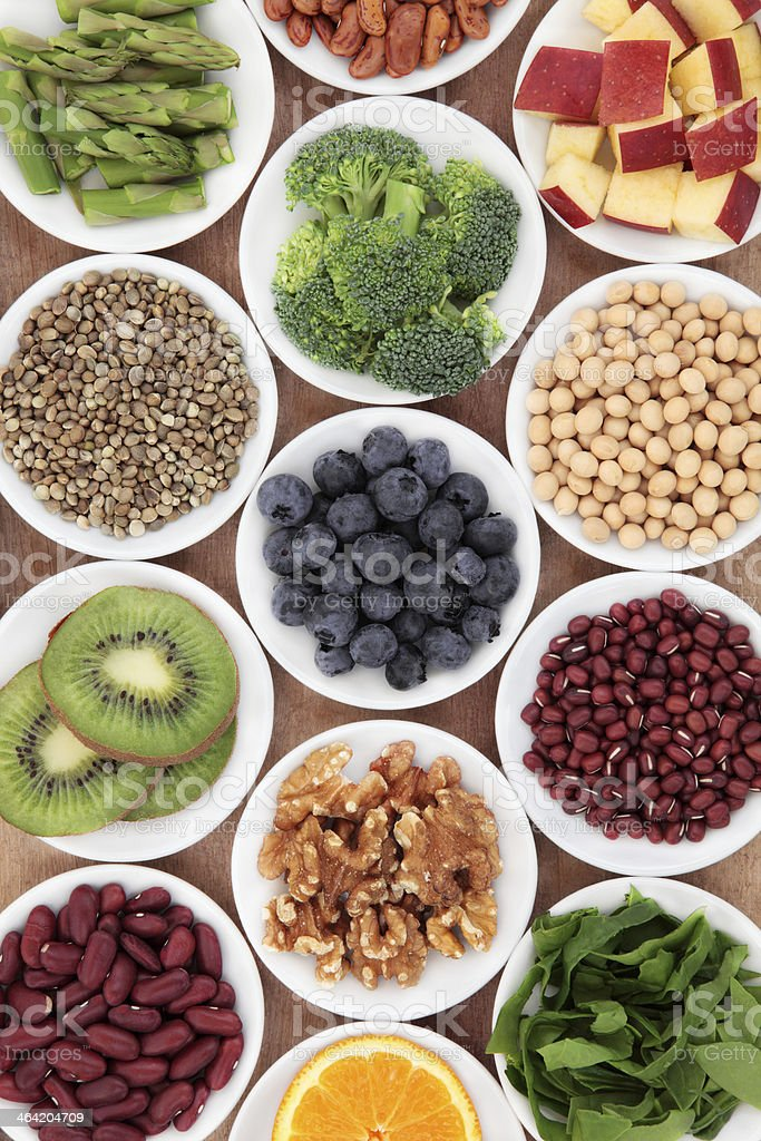 Selection of super foods in white bowls stock photo