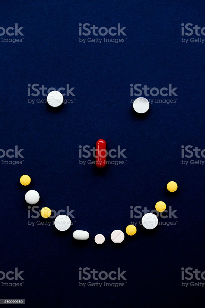 Selection of tablets in the shape of a smiley face stock photo