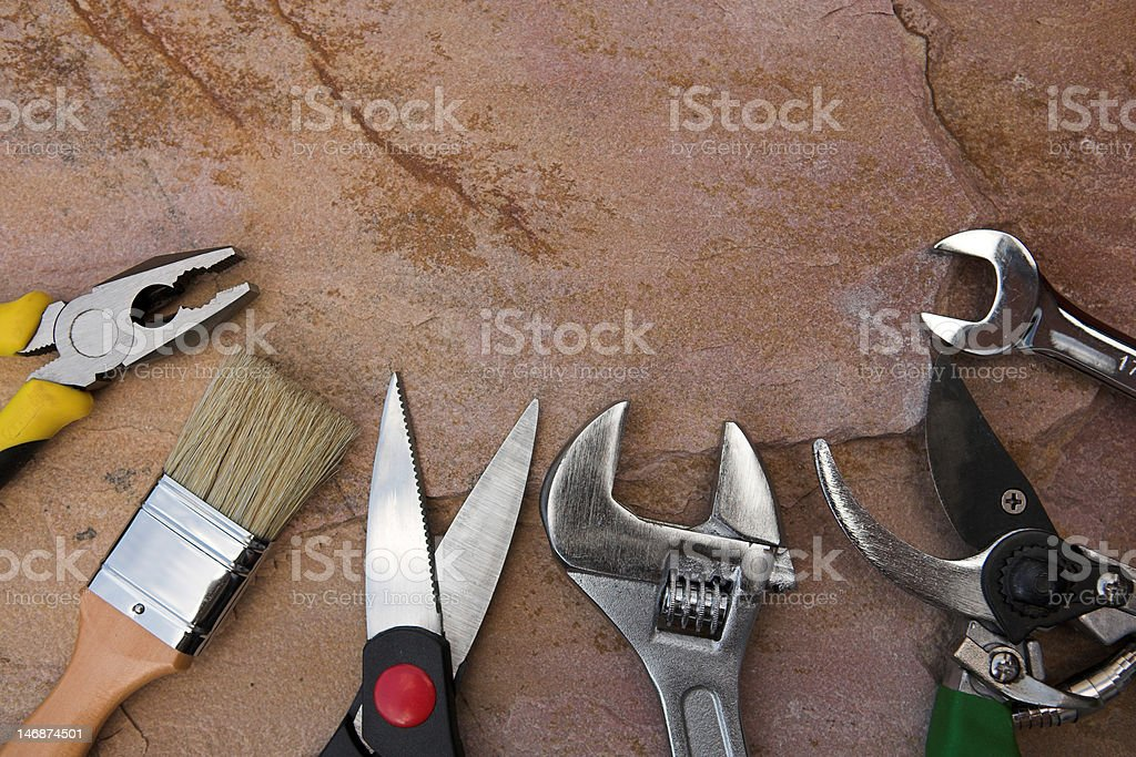 Selection of tools on a stone background royalty-free stock photo