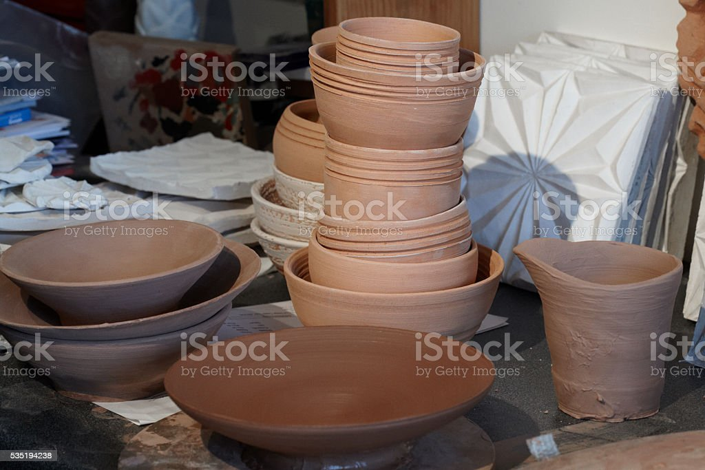 Selection Of Unglazed Pottery In Studio stock photo