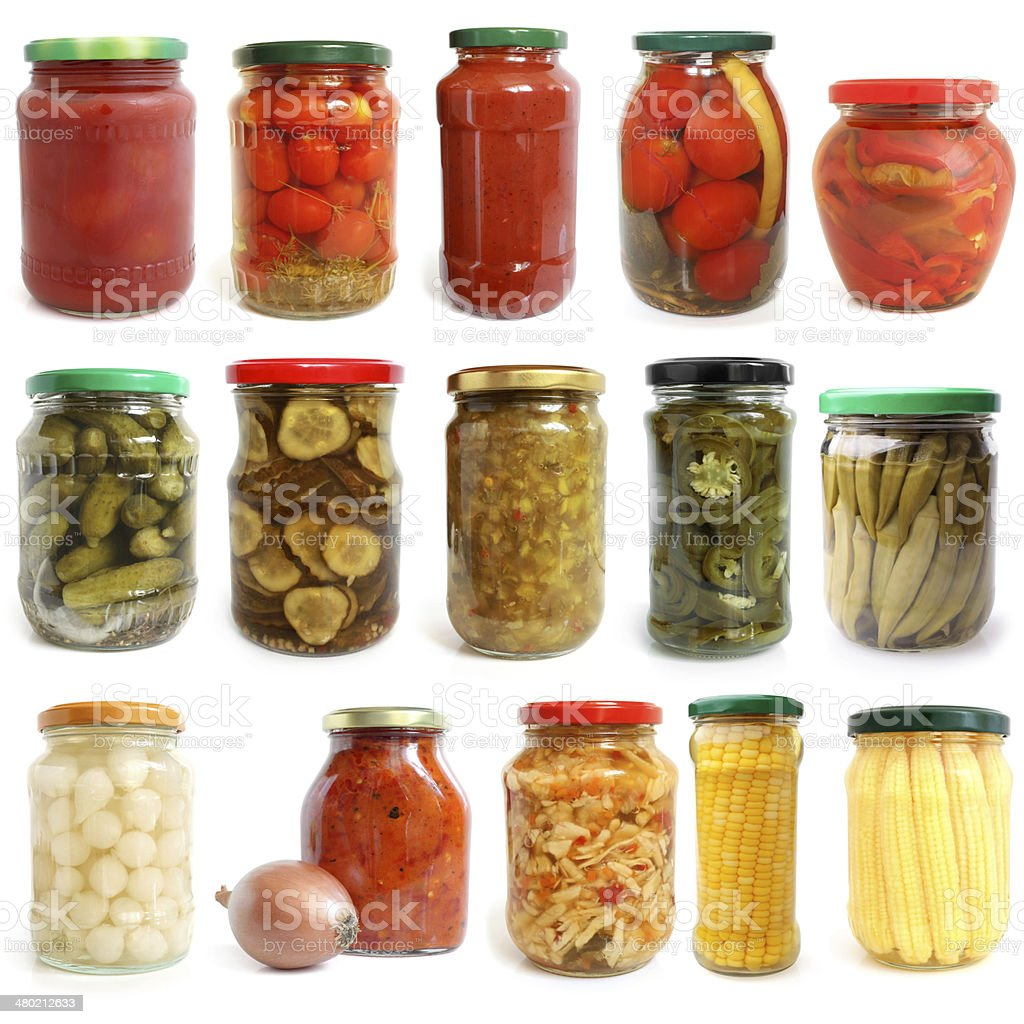 Selection of various vegetables canned in glass jars stock photo