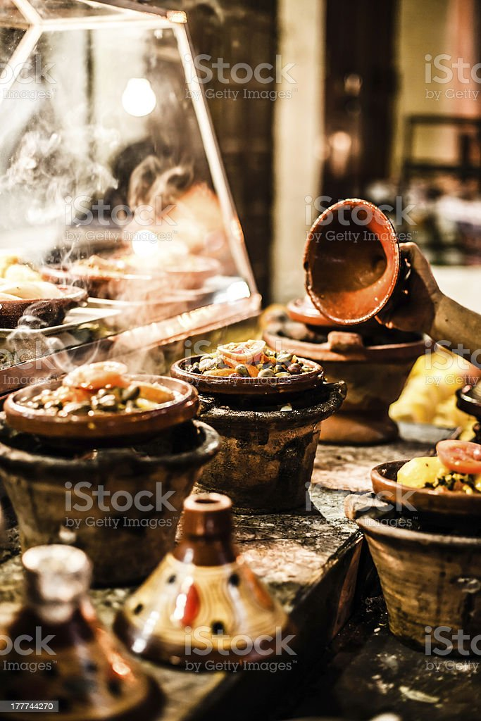 Selection of very colorful Moroccan tajines (traditional casserole dishes) stock photo