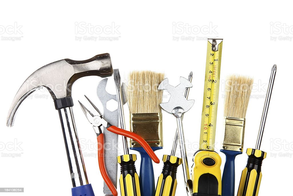 selection of work tools on a plain white background stock photo
