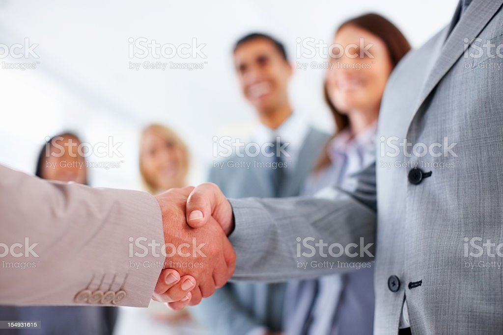 Selective focus businessmen shaking hands royalty-free stock photo