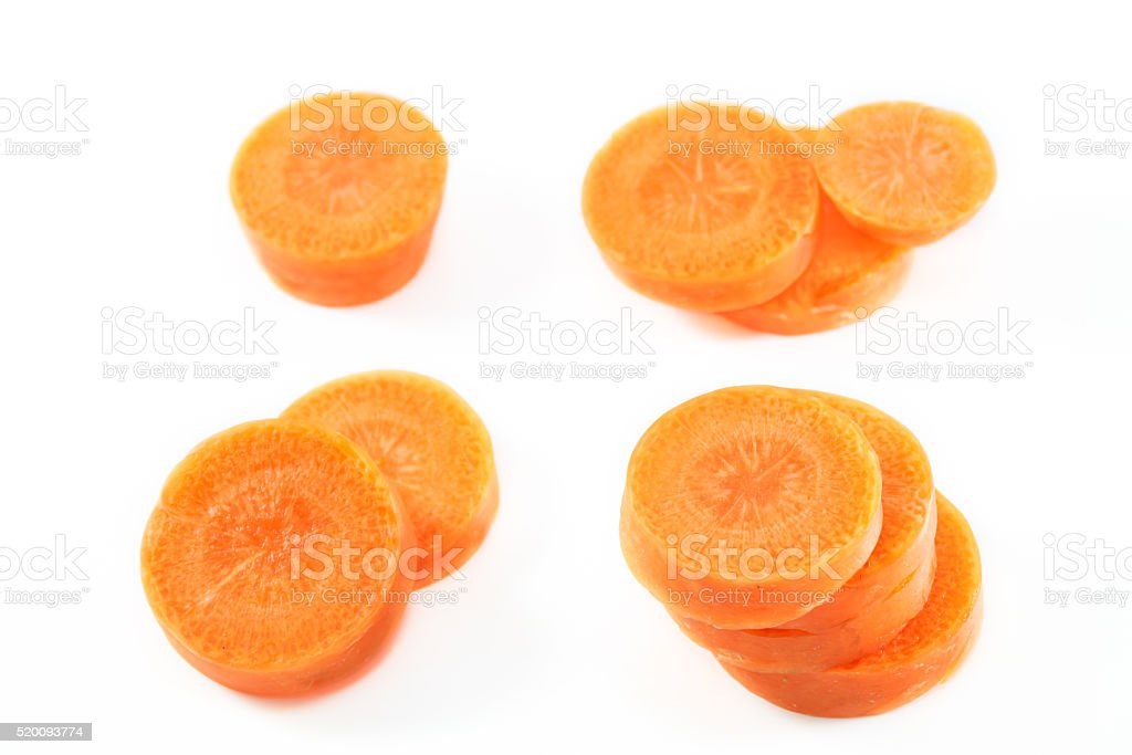 selective focus carrot slice on white background. stock photo