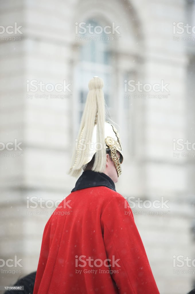 A selective focus of a life guard on the castle stock photo