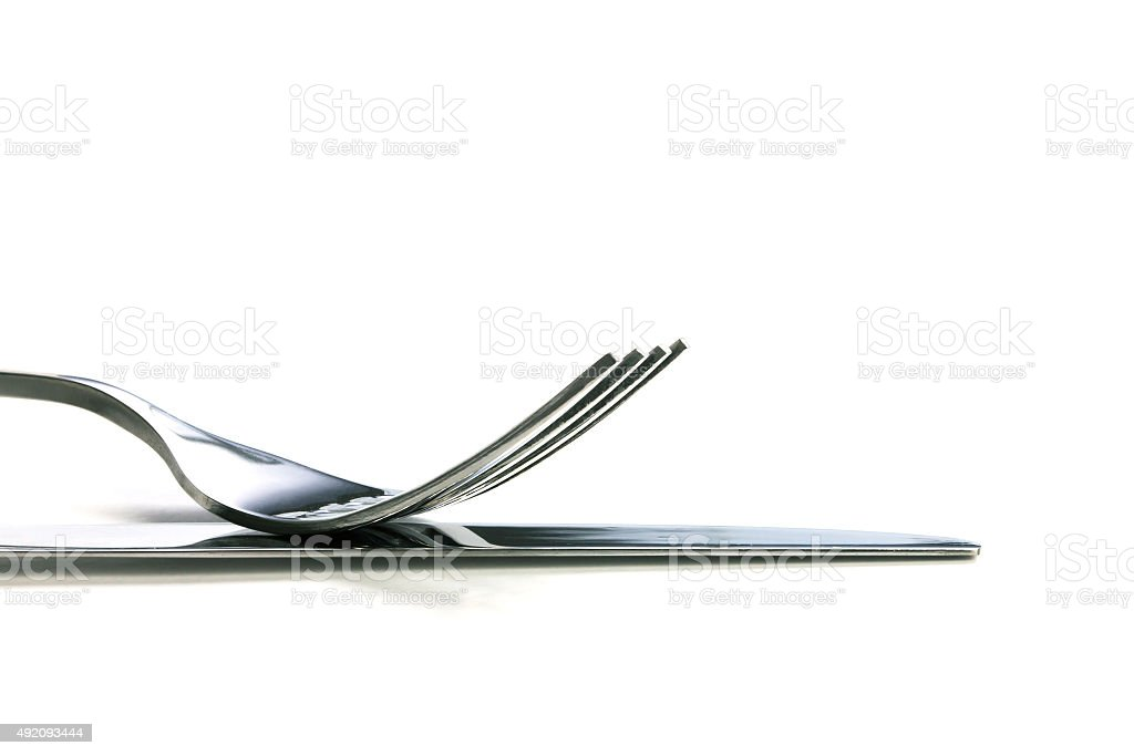 selective focus of close up dinning silverware fork and knife stock photo