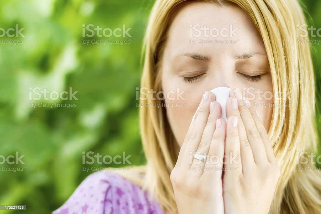 Selective focus of fingers holding the handkerchief sneezing royalty-free stock photo
