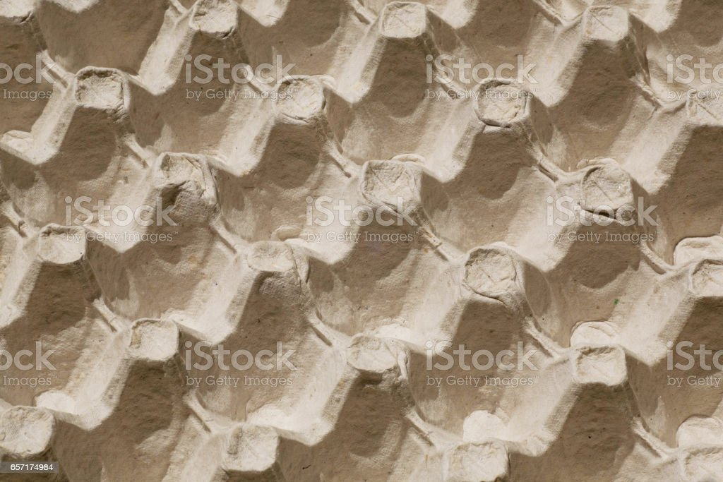 Selective focus on cardboard tray for eggs, abstract image like the repeating background stock photo