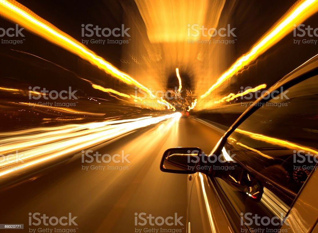 Selective focus photo of car driving at night royalty-free stock photo
