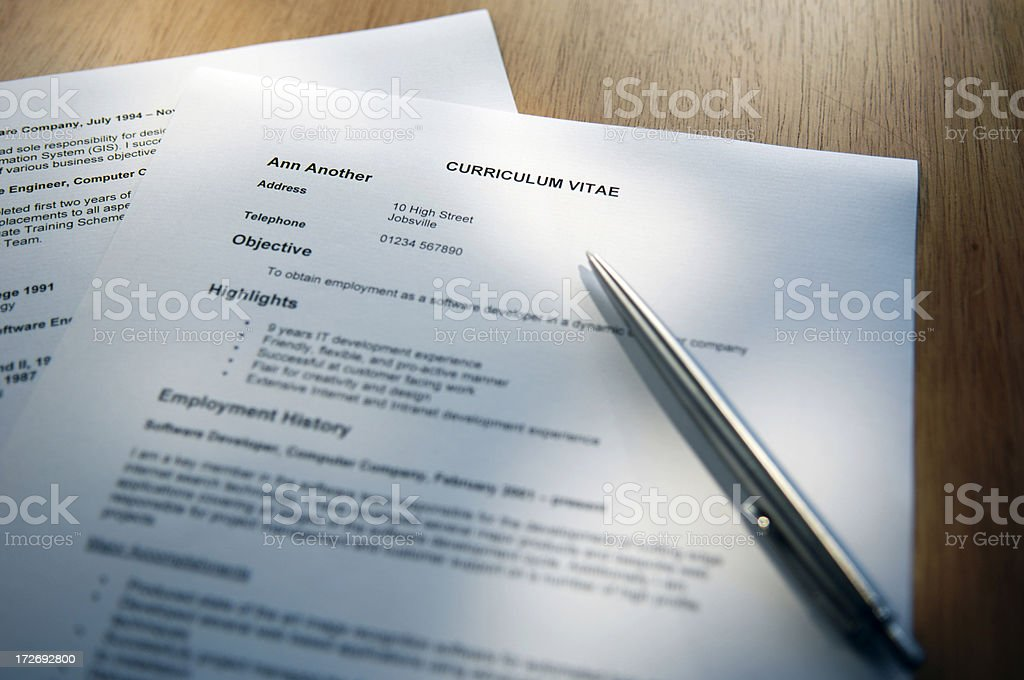 Selective focus shot of a resume and pen royalty-free stock photo