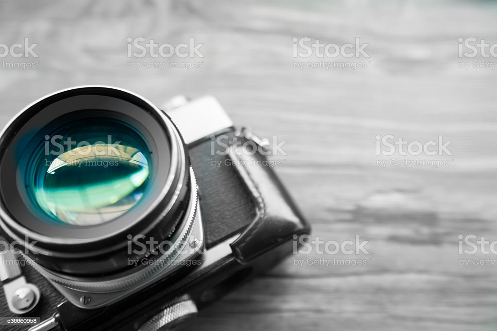 selective focus Vintage camera lens on old wood table stock photo