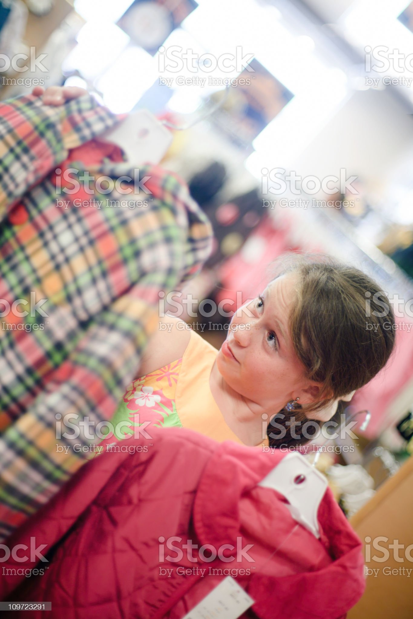 A Selective view of a little girl shopping clothes royalty-free stock photo