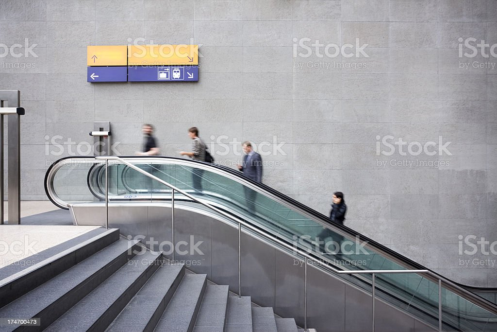 Self Absorbed People on Escalator Going to Work stock photo