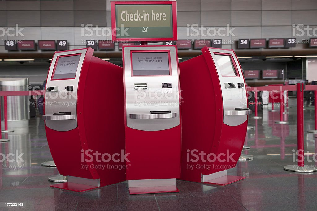 Self check in stations at airport stock photo
