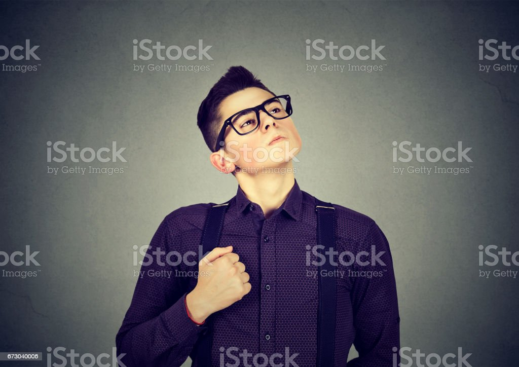 Self confident egocentric young man stock photo
